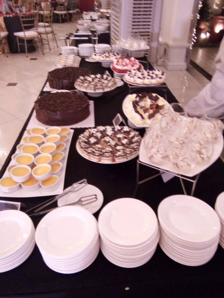 Dessert Table by Josiah's Catering served during our wedding. Photos taken from our guests.