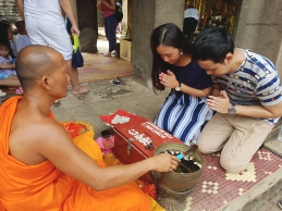 Water blessing from a Monk inside Angkor Wat