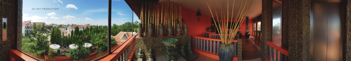 Floor hallway leading to the stairs and elevator featuring a taste of Khmer art